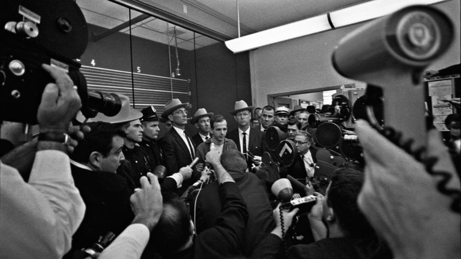 Elmer Boyd to the right of Lee Oswald at the press conference early on Nov 23rd.
