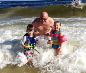 Teaching the kids the joys of jumping in the surf