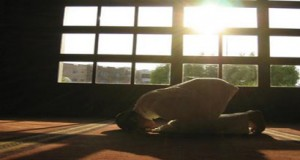 A person is prostrating during prayer.