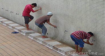 Some Muslims are performing ablution.