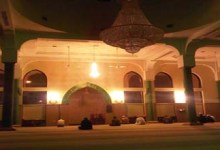 Some people are waiting in the mosque for Fajr Prayer.