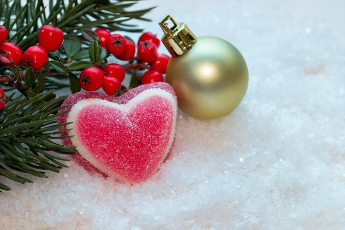 A picture of Christmas decorations that includes a pink heart.