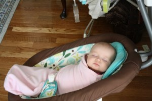 baby sleeping in papasan swing
