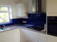 Royal blue splashbacks to kitchen