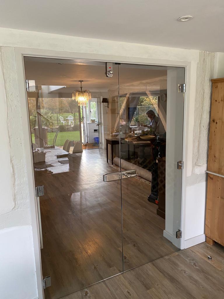 Frameless double doors to Kitchen