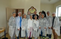 Rosemarie beside Fr. Shay and Felix Brockling with the Akbay-Preda Theatre group at the chocolate factory where the special Fair Trade chocolate is made.