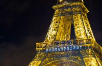 epa05057210 The front of the Eiffel Tower bears the message 'Human Energy' as part of a light installation entitled 'Human Energy' by artist Yann Toma drawing attention to human-generated power, on the sidelines of the COP21 Climate Conference, in Paris, France, 06 December 2015. The 21st Conference of the Parties (COP21) is held in Paris from 30 November to 11 December aimed at reaching an international agreement to limit greenhouse gas emissions and curtail climate change.  EPA/IAN LANGSDON