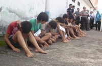 This picture taken on April 19, shows gang rape and murder suspects of a 14-year old girl at the police headquarters in Curup, Bengkulu. Indonesian President Joko Widodo announced harsher punishments for sexual offenders who prey on children, including chemical castration. (Photo by AFP)