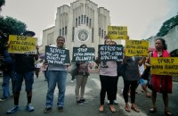 Members of the ecumenical group Promotion of Church Peoples' Response call on the government to observe human rights in the war against illegal drugs during a demonstration outside a Catholic church in Manila. (Photo by Vincent Go)
