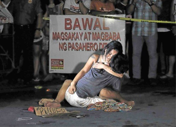 LAMENTATION A weeping Jennelyn Olaires hugs partner Michael Siaron, 30, a pedicab driver and alleged drug pusher, who was shot and killed by motorcycle-riding gunmen near Pasay Rotonda on Edsa. He was one of six killed in drug-related incidents in Pasay and Manila yesterday. RAFFY LERMA/INQUIRER FILE PHOTO