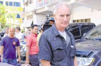 PETER Gerard Scully is being brought to the Lumbia City Jail in Cagayan de Oro where he would be detained while facing charges of child abuse and trafficking in this photo taken on Feb. 20, 2015