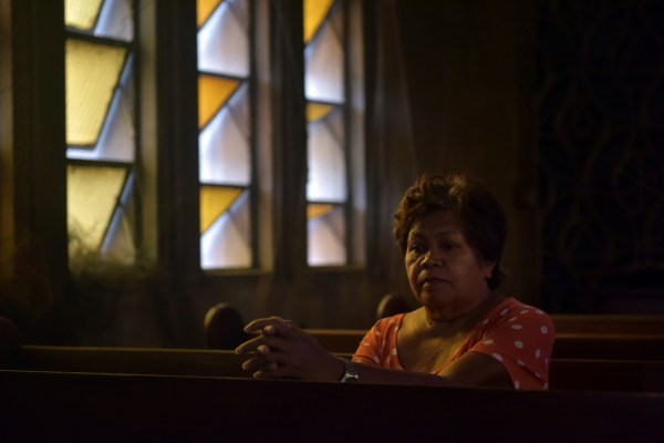 Elena de Chavez, 61, whose transgender daughter Heart was killed Jan. 10 in Navotas City, near Manila, by men believed to be police, meditates Feb. 17, 2017, in Redemptorist Church in Manila, where she and the rest of her family found refuge. (Jes Azna/For The Washington Post)