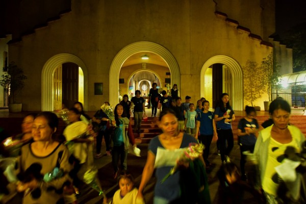 Relatives and friends of victims of extrajudicial killings leave Manila's Baclaran Church for a vigil Feb. 17, 2017. (Jes Aznar/For The Washington Post)
