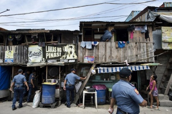 TOKHANG. Police implement Oplan TokHang, a literal door-to-door knock-and-plead operation that targets suspected drug users and pushers. It aims to curb demand. File photo by Noel Celis/AFP
