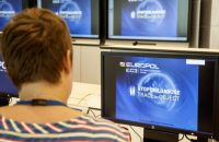 A Europol police agent looks at the onscreen logo of a new website launched by Europol at the Europol headquarters in The Hague on May 31, 2017. A particular shampoo brand, a magazine cover, a shopping bag or even a pattern on wallpaper are some clues Europol posted online on June 1, 2017, hoping it will help investigators identify child sex abuse victims. AFP