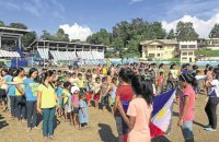 """Students of Alcadev and TRIFPSS at a flag-raising ceremony before classes in an evacuation center in Tandag City where they fled after militia men attacked """"Lumad"""" communities in Surigao del Sur. —NICO ALCONABA"""