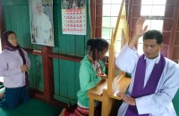 A priest hears confession in Shan State, Myanmar. There are about 700,000 Catholics in the Buddhist-majority country. (ucanews.com photo)