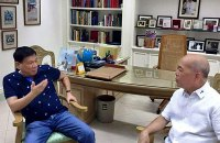 In this Dec. 4, 2015 photo, then presidential candidate Rodrigo Duterte speaks with Davao Archbishop Romulo Valles days after his controversial speech where he complained about Pope Francis' visit in the Philippines.