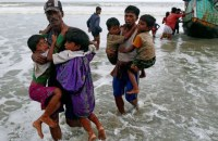 Rohingya refugee children carried to the shore after crossing the Bangladesh-Myanmar border by boat in Teknaf (Reuters File Photo)
