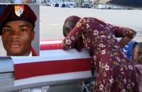 Sgt Johnson's widow with his coffin at Miami International Airport