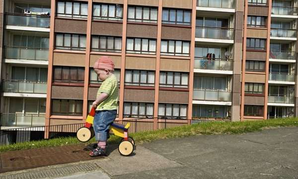 A boy playing in Whitehawk housing estate, Brighton. Photograph: Photofusion/REX/Shutterstock