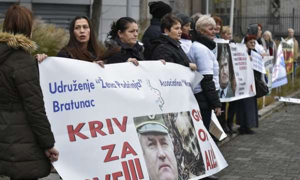 People, including victims, protest in front of the international criminal tribunal for the former Yugoslavia (ICTY) prior to the verdict Photograph: John Thys/AFP/Getty Images