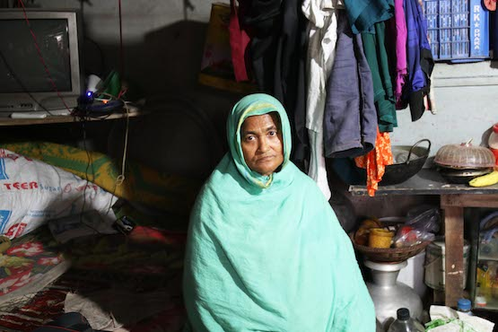 Rahima Begum, 55, a poor Muslim slum dweller in Dhaka on Nov. 26. Bangladesh's poor, oppressed minorities and indigenous communities hope Pope Francis' upcoming visit would promote harmony, peace and human rights. (Photo by Stephan Uttom/ucanews.com)
