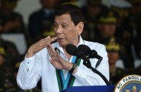 Philippine President Rodrigo Duterte delivers a speech during a ceremony marking the anniversary of the military at Camp Aguinaldo in Quezon City, suburban Manila on Dec. 20, a day after announcing his tax reforms. (Ted Aljibe/AFP)