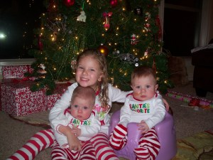 Camdyn and Cade at 8 months old with big sister, Brenna