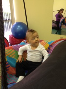 Enjoying the therapy swing during an OT session