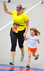 My daughter and I crossing the finish line at my first 10 mile event