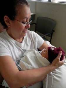 Nana holding my son Caleb for the first time.