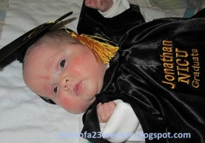 NICU graduate in gown