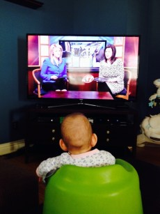 Peyton watching Mommy on the news.
