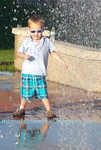 Boy splashing special needs prematurity, hand to hold, preemie babies 101, NICU, Life after NICU