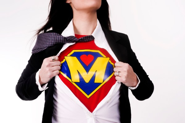 Super mom, NICU, advocate, advocating, Woman wears a superhero style t-shirt under her business suit