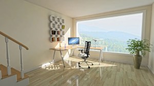 Clean room with table, monitor, chair, shelf and big window after decluttering your home