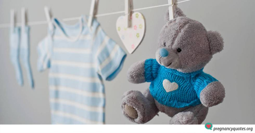 Congrautlations for having a baby boy message with clothesline, blue clothes and a teddy bear