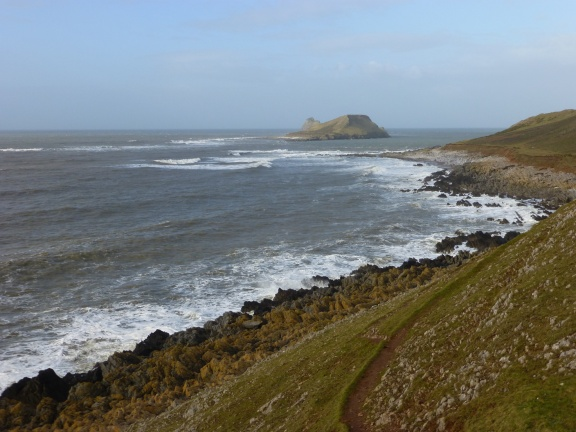 The coast line with Worms Head, an island that can be reached only during low tide.