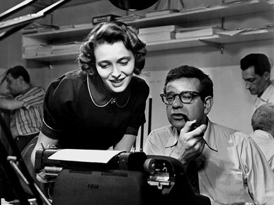 "Patricia Neal and Walter Matthau on the set of ""A Face In The Crowd"" in 1957"