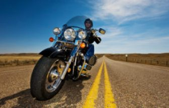 image of a man riding a motorcycle — motorcycle safety tips for new owners