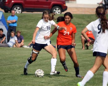 Timpview defender Weslee Baird works to fend off Olivia Burnett of Timpanogos. (Photo by Kurt Johnson)