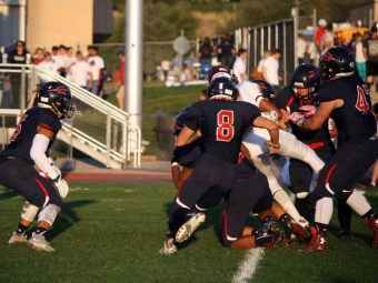 The Springville defense held Maple Mountain to 27 yards rushing on 21 carries. (Photo by Kurt Johnson)