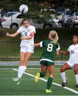 Skyline striker Holly Daugirda wins a ball in the air in the game against Olympus. (Photo by Kurt Johnson)