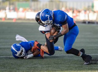 Simote Lokotui (3) and Tongi Langi (10) combined for a Bingham tackle Friday night against Bishop Gorman. (Photo by Dave Argyle, dbaphotoraphy.com)