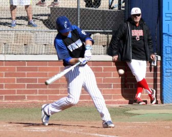 Tate Briggs delivers the first of three straight RBI singles in the Pleasant Grove third. (Photo by Kurt Johnson)
