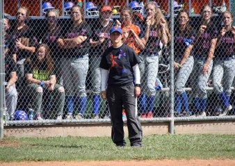 Timpview softball coach Debbie Dodds with her team in the dugout behind her. (Photo by Kurt Johnson)