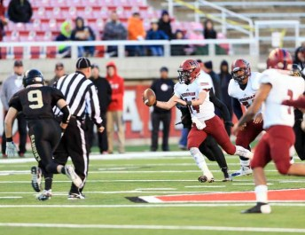 Hayden Reynolds eludes the Lone Peak defense in time for a huge completion. (Photo by Kevin McInnis)