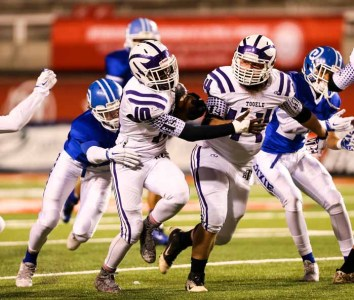 Lincoln Powers leads the way for a talented Tooele running game. (Photo by Kevin McInnis)