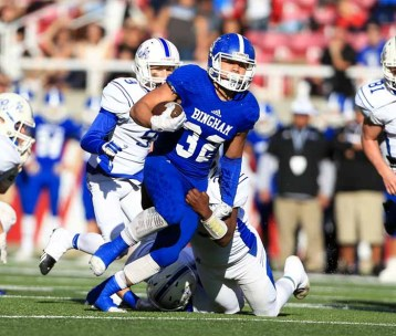 Amoni Kaili had a big day running the ball for Bingham in the state semifinal. (Photo by Kevin McInnis)